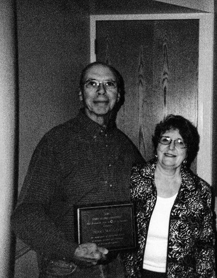 Terry Maggart received the 2015 Unity in the Community award from Pat Pennell, treasurer of the Jacksonville Area Conference of Churches. Maggart was presented with a plaque and $100 for his efforts to support Christian values in his community service. Photo: Submitted Photo