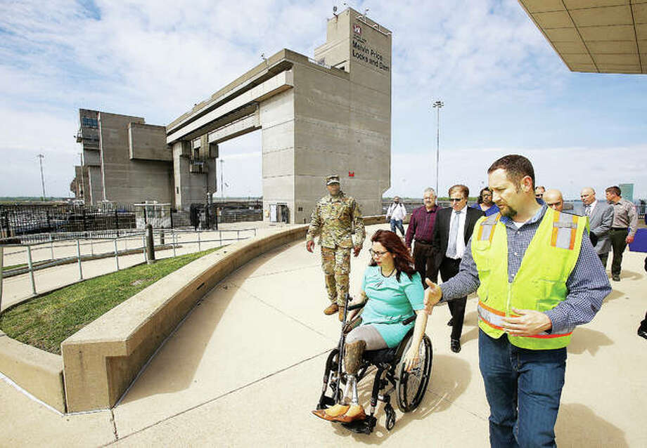 U.S. Army Corps of Engineers officials and Alton Mayor Brant Walker escort U.S. Sen. Tammy Duckworth, D-Ill., center, as she takes a tour of the Melvin Price Locks and Dam 26 Tuesday in Alton. Duckworth met with officials to discuss the need for funding for the aging system of dams on the upper Mississippi River. The Melvim Price Dam is 27 years old and is the newest dam in the river system. Photo: John Badman   The Telegraph