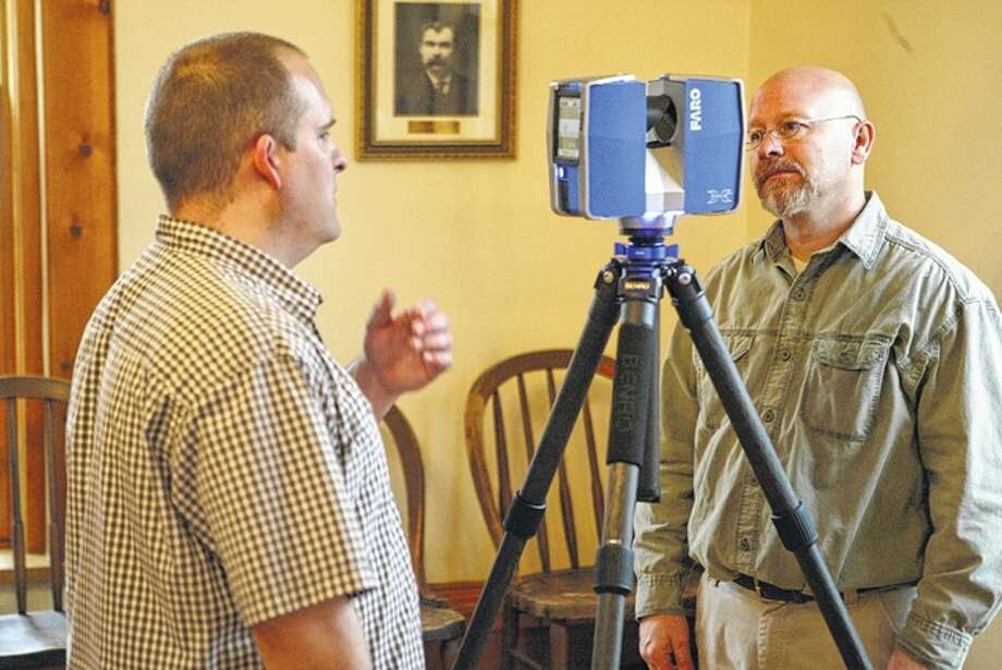 Bob Hohimer Jr. and Brent Wassi of U.S. Laser Scanning set up the FARO laser scanner Wednesday to take a 3-D image of the Old Lincoln Courtroom and Museum in Beardstown. Photo: Nick Draper | Journal-Courier