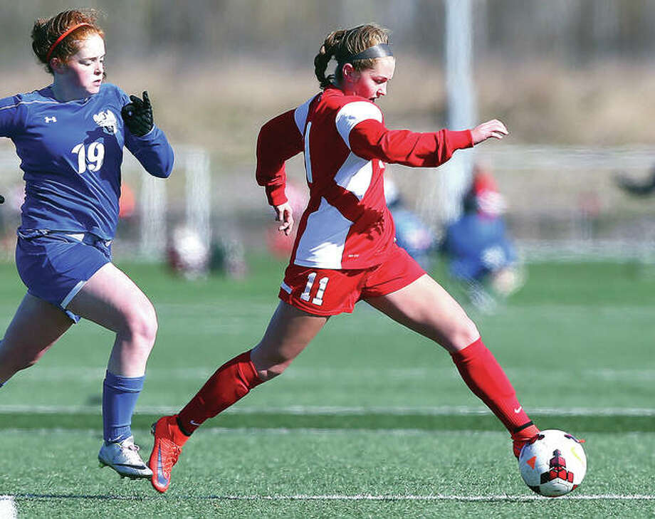 Alton's Brianna Hatfield (11) scored her 12th goal of the season Tuesday night in the Redbirds' 3-0 victory over Trinity Catholic High in Hazelwood. She is shown in action last season against Washington, Mo. Photo: Billy Hurst File Photo | For The Telegraph