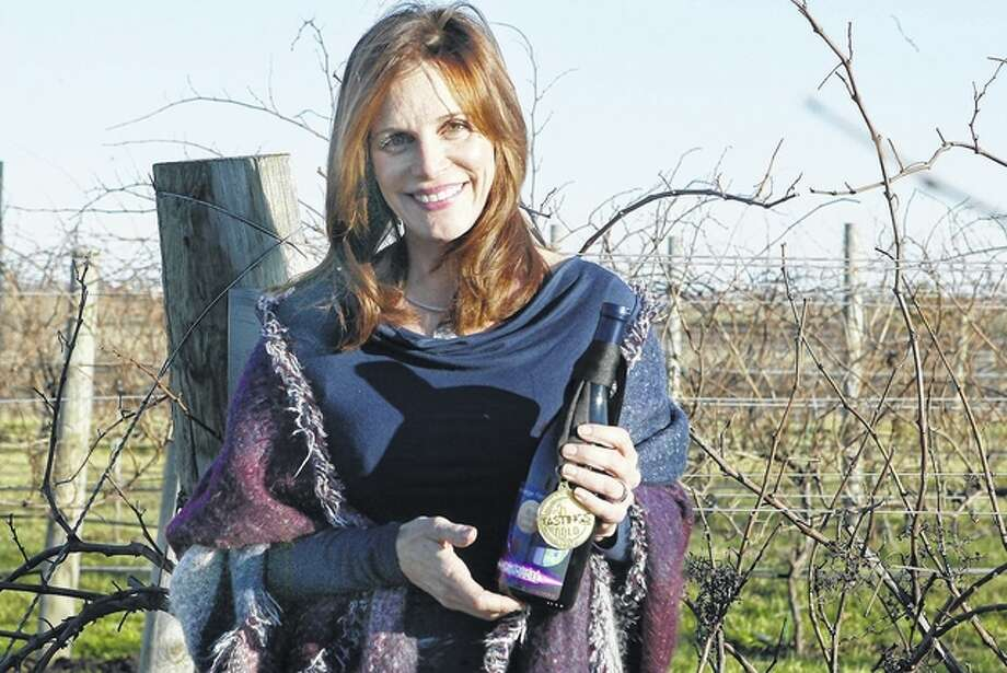 Susan Danenberger was awarded a gold medal in the World Wine Championships for her 2012 Desagace CoupDeFoudre. Photo: Samantha McDaniel-Ogletree | Journal-Courier