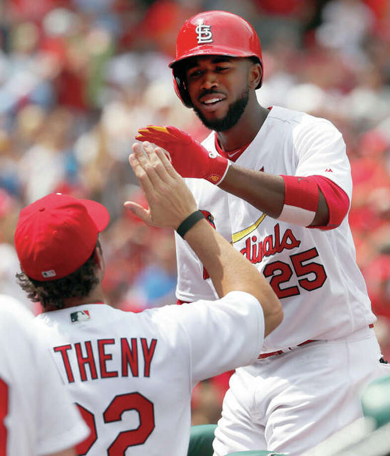 Cardinals leadoff hitter Dexter Fowler (right) is greeted by manager Mike Matheny after Fowler hit his second solo home run Wednesday in a 2-1 victory over the Pittsburgh Pirates at Busch Stadium. Photo: Associated Press
