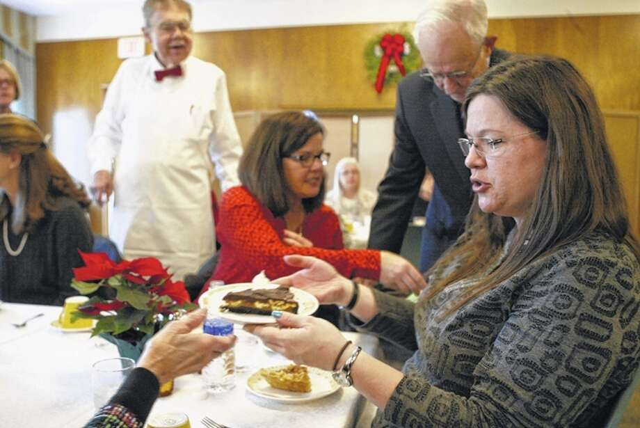 Elizabeth Becker of Jacksonville passes a piece of cake at the Trinity Episcopal Church holiday bake shoppe, bazaar and luncheon. The bazaar has happened annually for over 50 years and is the church's biggest fundraiser for outreach programs. Photo: Nick Draper | Journal-Courier