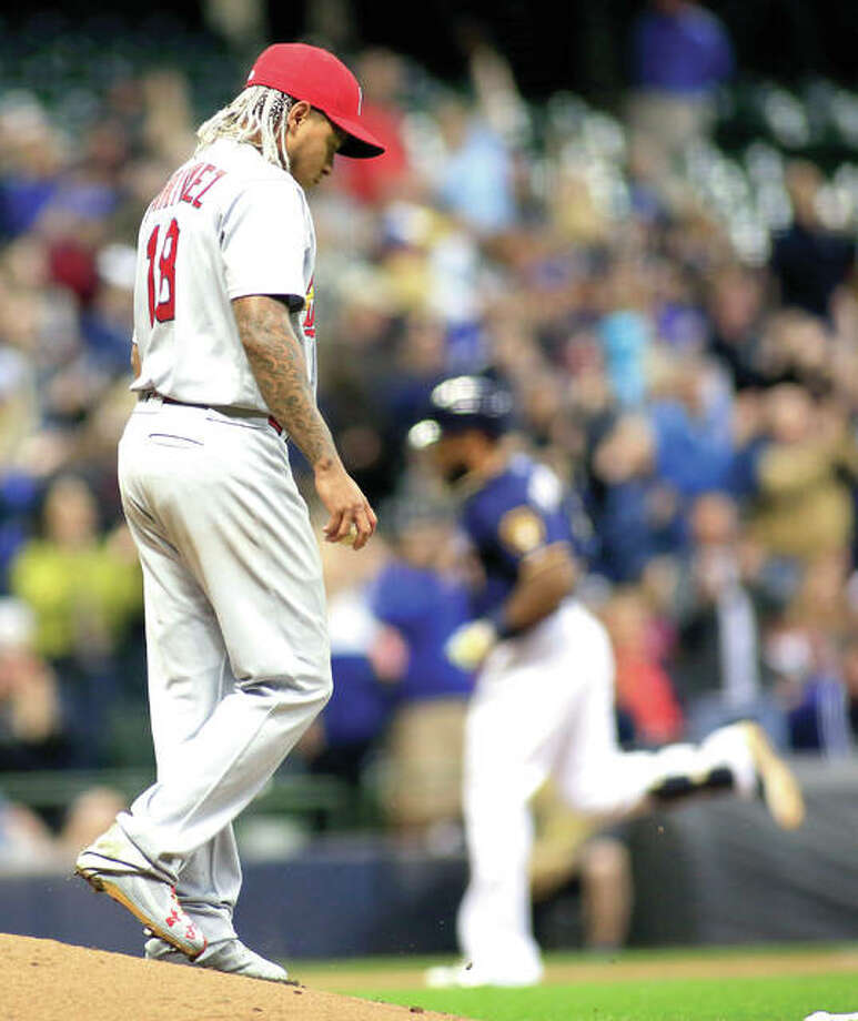 Cardinals pitcher Carlos Martinez, left, walks off of the mound after giving up a two-run home run to Milwaukee Brewers' Eric Thames in the fifth inning of Thursday's game in Milwaukee. Photo: AP