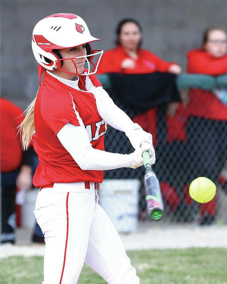 Alton's Sydney Hartman, shown connecting for a hit during a March 22 victory over Bunker Hill at Alton High, had a double and home run with three RBIs Friday in the Redbirds' victory over Civic Memorial at the Bethalto Sports Complex. Photo: Billy Hurst / For The Telegraph