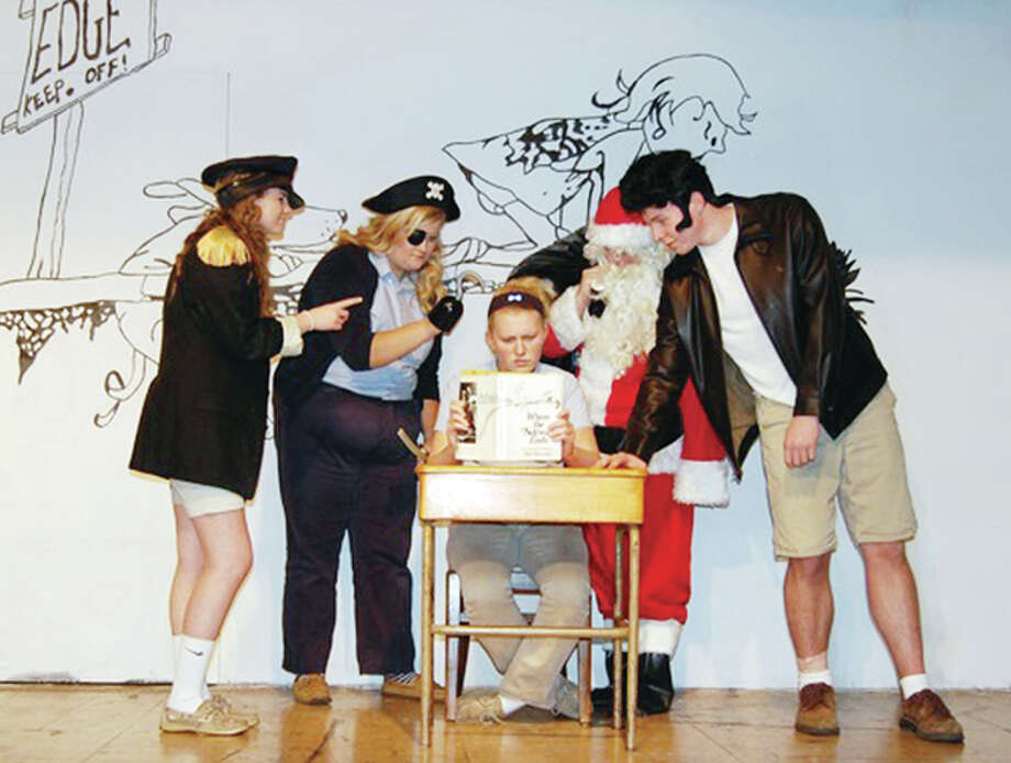 "Maddie Nelson as Super Ego (from left), Erika Bone as Captain Hook, Cole Burke as Santa Claus, Thomas Coates as Mr. Cool and Madison Brockhouse (seated) as Keri O'Niell rehearse a scene from ""Where the Sidewalk Ends."" The play, based on the poems of Shel Silverstein, will be featured during Routt Catholic School's annual Winter Arts Extravagana. The event at 7 p.m. Sunday at the school also will feature student artwork and a performance by Routt's band. Photo: Submitted Photo"