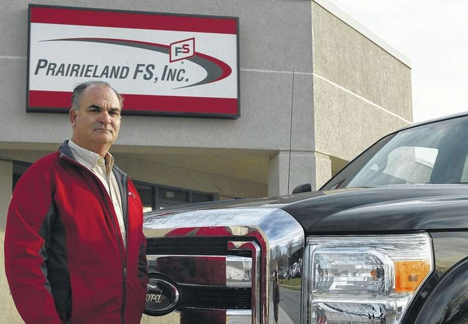 Prairieland FS energy operations manager Brad Blair stands next to a 2016 Ford F250 pickup truck that Prairieland FS will soon convert to a bi-fuel vehicle capable of using both gasoline and propane.