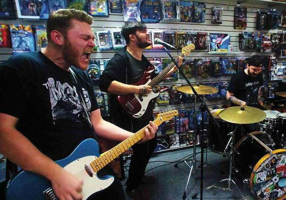 Alton-based punk rock band Walloper performs Saturday at Slackers CD's and Games as part of Record Store Day. The store hosted an entire lineup of eclectic local bands as part of a national event to drive interest in music and local acts. Photo: Nathan Woodside | For The Telegraph