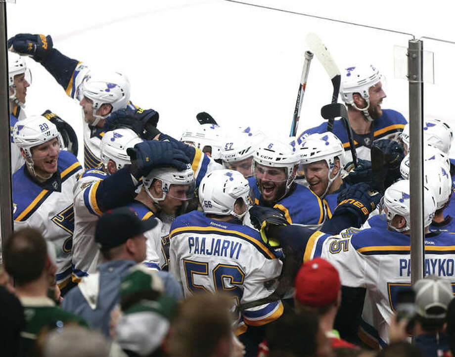 Blues' Magnus Paajarvi (center) is swarmed by his teammates after scoring the game-winning goal during overtime in Game 5 of a Stanley Cup first-round playoff series against the Wild on Saturday St. Paul, Minn. St. Louis won 4-3 to win the series 3-1. Photo: Associated Press