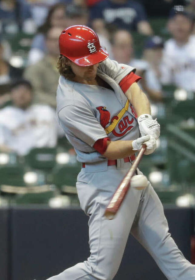 Cardinals pitcher Mike Leake hits a two-run scoring single during the fourth inning of St. Louis' win Sunday against the Brewers in Milwaukee. Photo: Associated Press