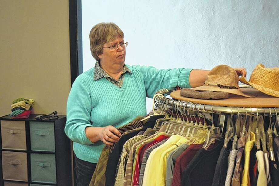 Rita Briggs, co-manager of Grace Place Thrift Store and Ministry Center at 29 S. Central Park, works at the store Friday preparing for today's opening. Photo: Greg Olson | Journal-Courier
