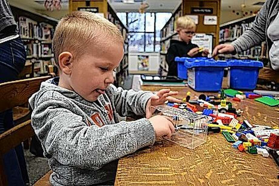 Emmett Murray, 4, and Dean Haley, 6, build contraptions out of Lego Friday at the Jacksonville Public Library Lego Club. The Lego Club meets on the second Friday of each month from 2:30 to 4:30 p.m. Kids are invited to stop in and join in the Lego fun. Photo: Nick Draper | Journal-Courier