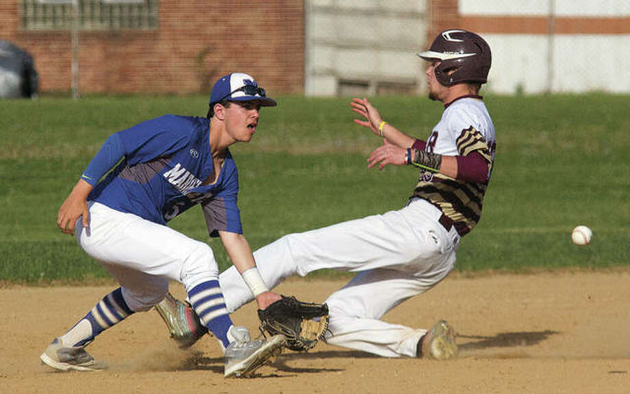 EA-WR's Hunter Hall (right) slides safely past Marquette Catholic shortstop Zach Weinman for a stolen base in Prarie State Conference baseball action Monday at Norris Dorsey Field in Wood River. Photo: Nathan Woodside / For The Telegraph