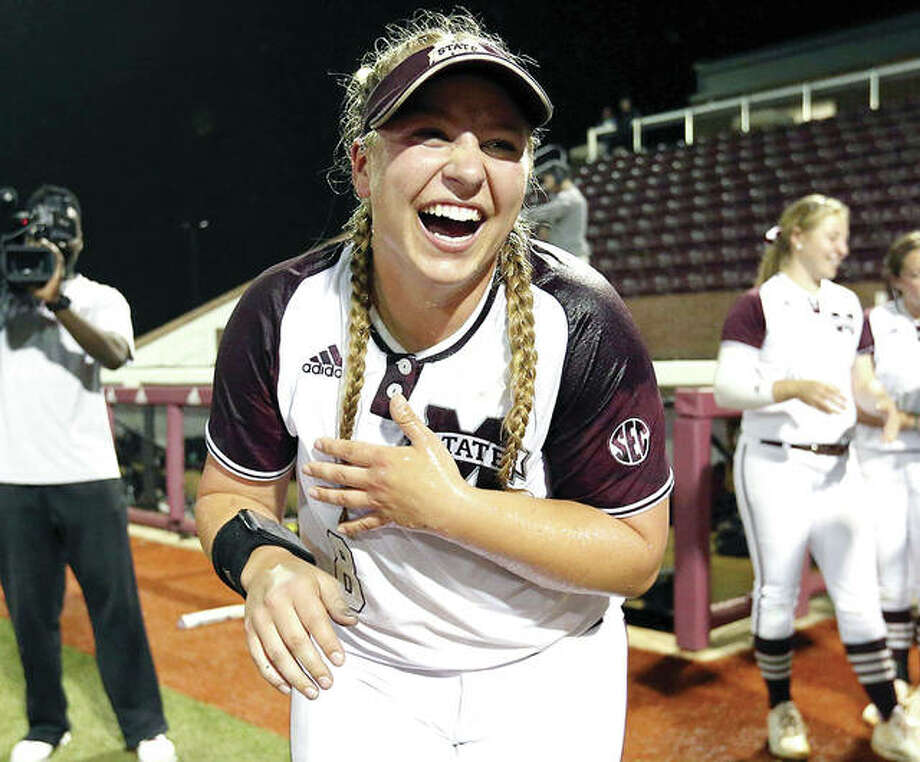 Former Marquette Catholic High pitcher Alexis Silkwood celebrates after pitching her Mississippi State University team past Arkansas Monday night in Starkville, Mississippi. Earlier Monday, Silkwood was drafted by the Akron Racers of National Pro Fastpitch softball. Photo: Kelly Price | MSU Athletics