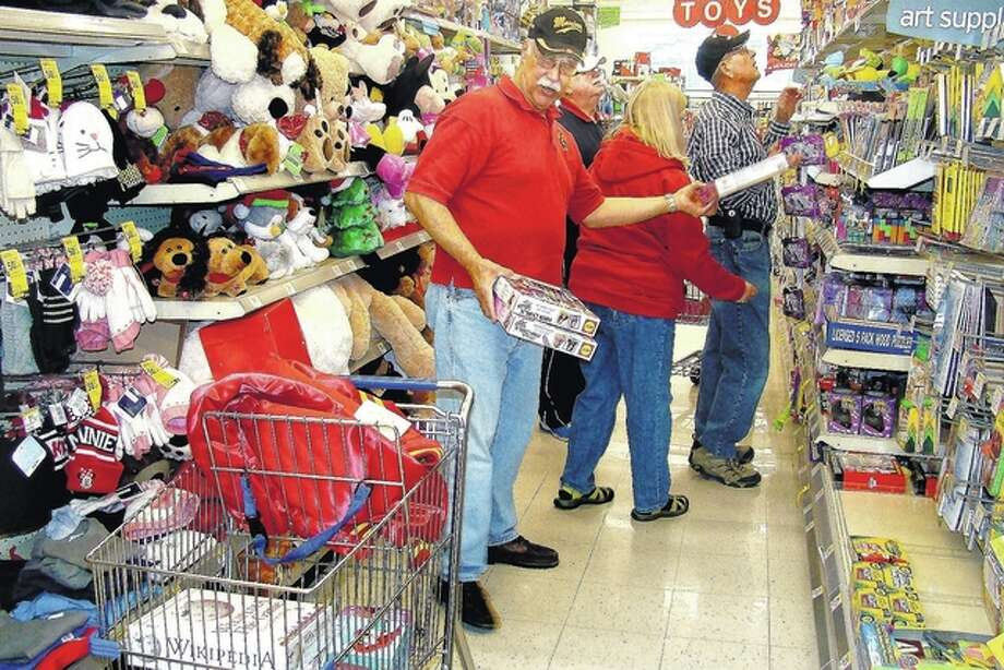Roger Deem | Journal-Courier Tim Ritzo makes his way through the toy aisle to add to the gifts donated throughout the Christmas season for the Toys for Tots program.