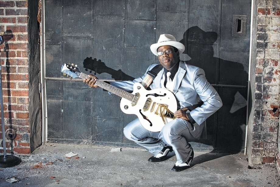 Jacksonville musician Robert Sampson, who will compete in his seventh International Blues Challenge in Memphis, Tennessee, in January, poses with his favorite guitar, which he has named Angel.