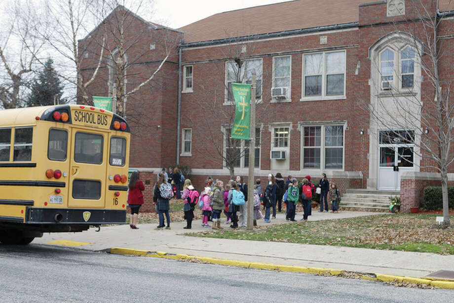 Our Saviour School students mill around in front of the school, which has seen an increase in enrollment in recent years and may — in the next few years — get a building addition to accommodate growth. Photo: Greg Olson | Journal-Courier