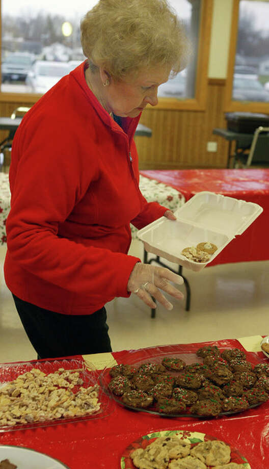 Evelyn Suess of Jacksonville looks through the baked goods for sale Thursday for the Jacksonville Area Senior Center cookie walk at the Community Center in Community Park. Photo: Samantha McDaniel-Ogletree | Journal-Courier