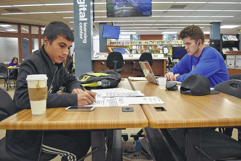 Tek Dahal (left) and Brendan Barlow, both juniors at Illinois College, study for the last days of finals. Dahal was tackling economics and finance, while Barlow was brushing up on his psychology. The last day of finals for Illinois College is Monday. Photo: Nick Draper | Journal-Courier