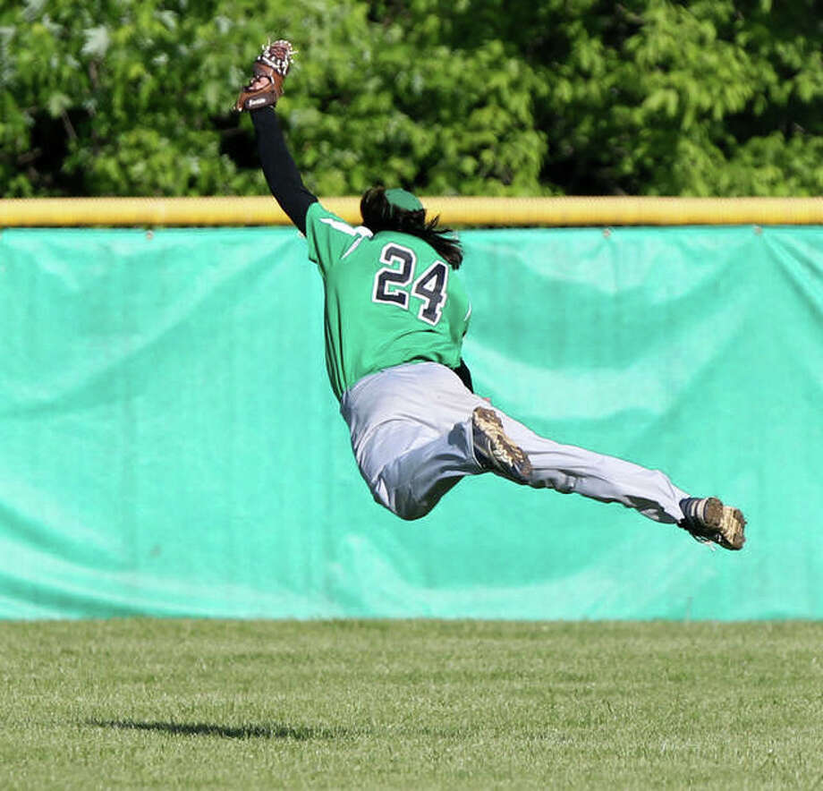Carrollton center fielder Jeremy Watson makes a leaping catch with his back to the infield during a game against Calhoun Thursday in Carrollton. Photo: Dennis Mathes / Journal-Courier