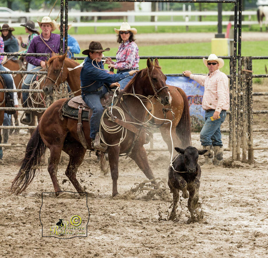 Tyler Manion, a Waverly High School sophomore, competes in a calf roping competition during the 2015 Illinois High School Rodeo Association season. Photo: Photo Submitted By Prairie Rodeo Photography