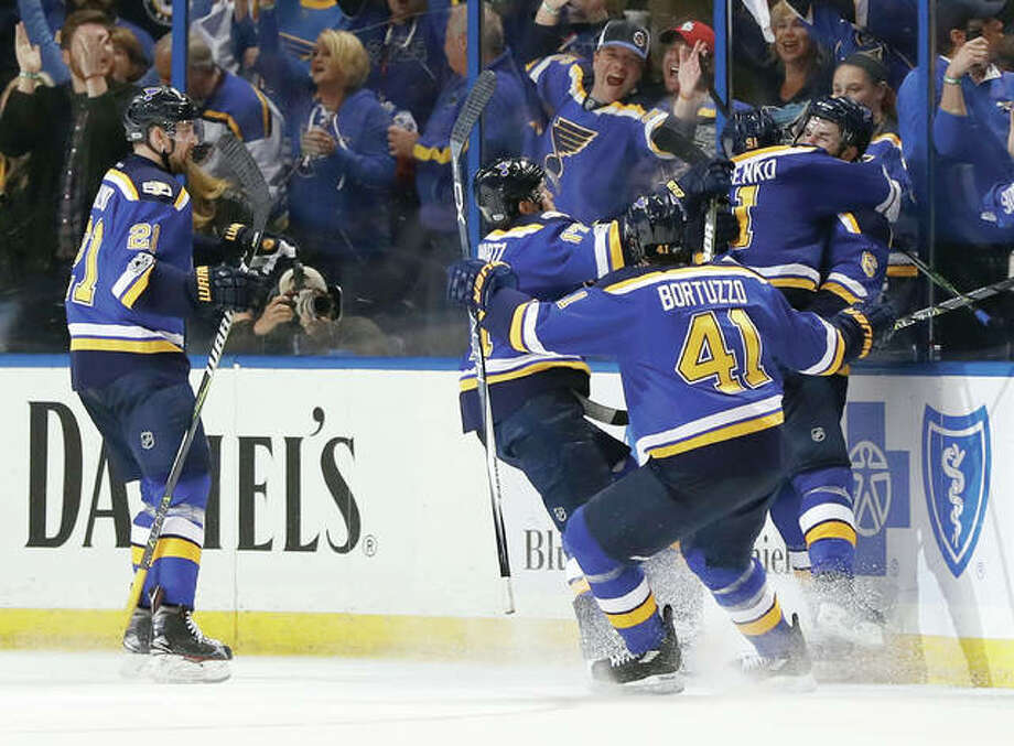 Blues players celebrate after right wing Vladimir Tarasenko (91) scored the winning goal against the Nashville Predators late in the third period in Game 2 Friday in St. Louis. The Blues won 3-2 to even the series 1-1. Photo: Jeff Roberson | AP