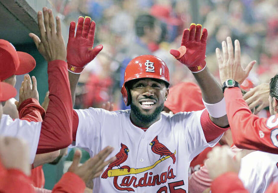 The Cardinals' Dexter Fowler celebrates with teammates after hitting a two-run home run against the Reds in the third inning Friday in St. Louis. Photo: Tom Gannam | AP