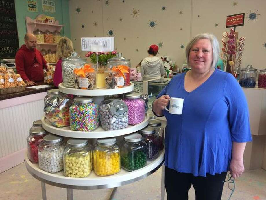 Alex Heeb/The Telegraph Rebecca Pattan stands in Poputopia, her recently opened confectionery shop in Alton. The shop stocks dozens of flavors and varieties of popcorn, as well as other sweets.