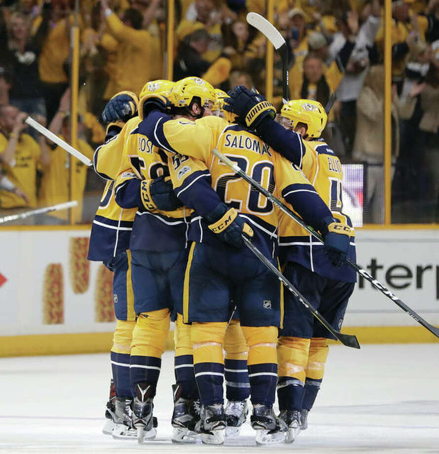 Nashville players congratulate defenseman Roman Josi after he scored a goal to put the Predators up 3-1 over the Blues during the third period in Game 3 of their second-round NHL playoff series Sunday in Nashville, Tennessee. Photo: Associated Press