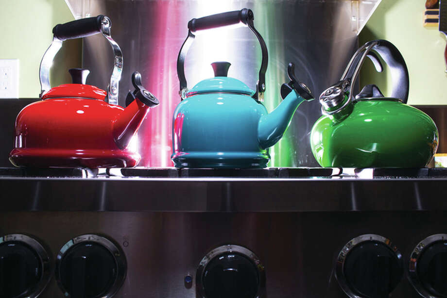 At Mrs. Cook's at University Village in Seattle, they'll help you test tea kettles to find one to your liking. Among their options: Le Creuset (from left), classic style in cherry; Le Creuset, demi style in Caribbean; and Chantal, loop style in emerald. Photo: John Lok | Seattle Times | TNS