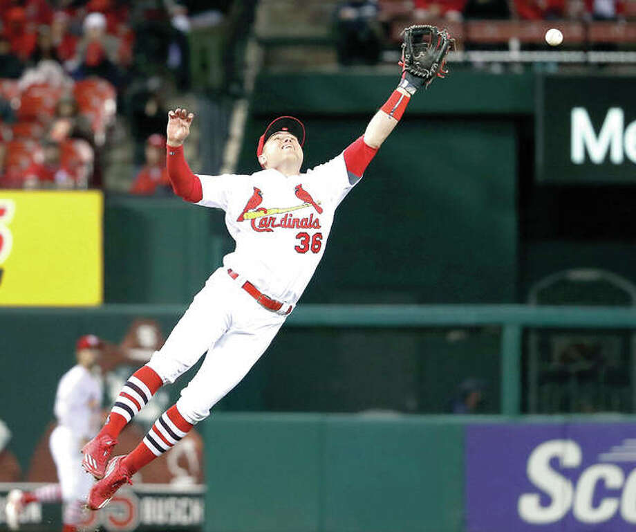 Cardinals shortstop Aledmys Diaz is unable to catch a single by the Brewers' Travis Shaw in the sixth inning of Monday's game at Busch Stadium. Photo: AP