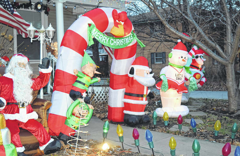 South Prairie Street features a lot of festive houses, such as this impressive display that features Santa in a helicopter. Photo: Nick Draper | Journal-Courier