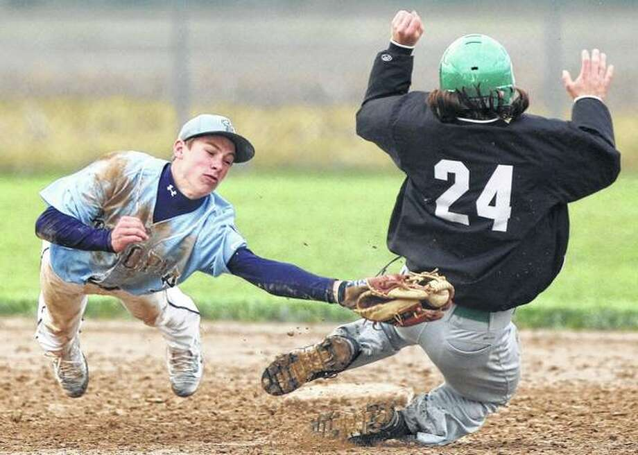 Concord Triopia's Zach Thompson (left) just misses as he div s to try to tag out Carrollton's Jeremy Watson at second base on a steal attempt during a game at Concord on Monday night. Photo: Dennis Mathes / Journal-Courier