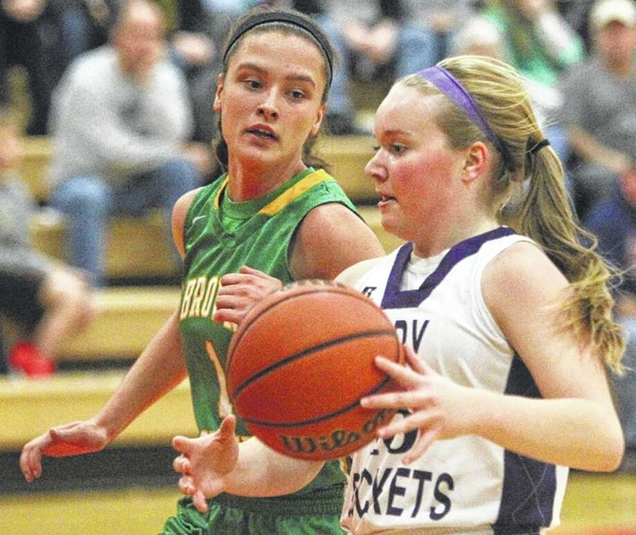 Routt's Mallory Martin tries to get past Brown County's Kelly Buss at the Beardstown Lady Tiger Classic Saturday. Photo: Dennis Mathes | Journal-Courier
