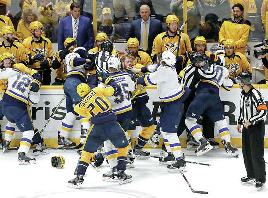 Predators and Blues players scuffle during the third period of Tuesday night's Western conference semifinal series game in Nashville, Tenn. The Predators won 2-1 to take a 3-1 lead in the series. Photo: AP