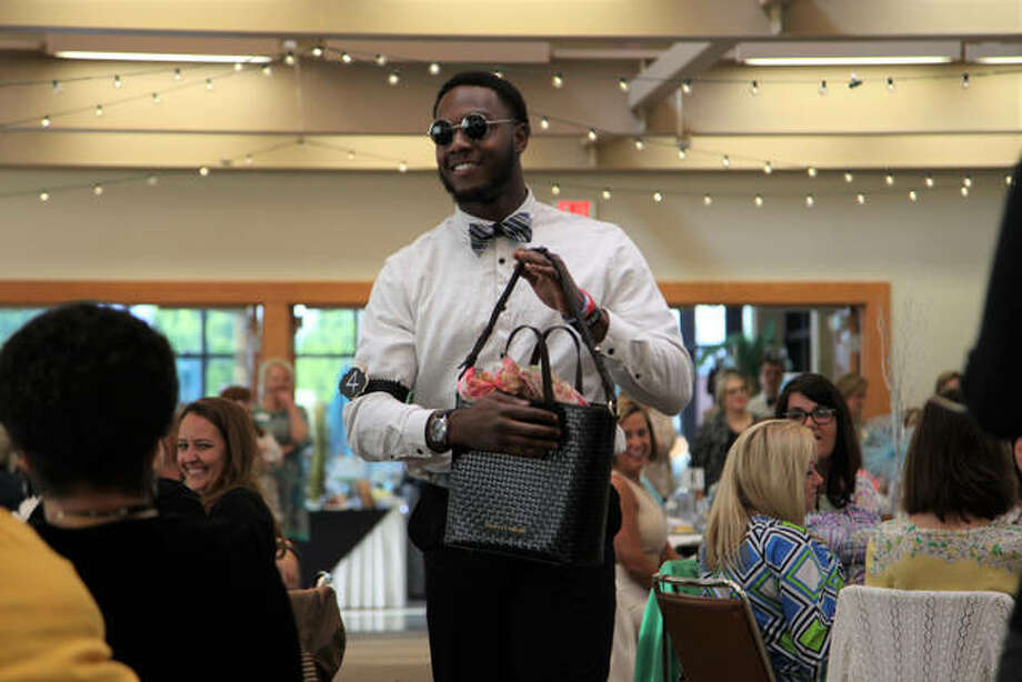 Aaron Womack, one of the local volunteer models, struts his stuff at the event. Photo: United Way | For The Telegraph