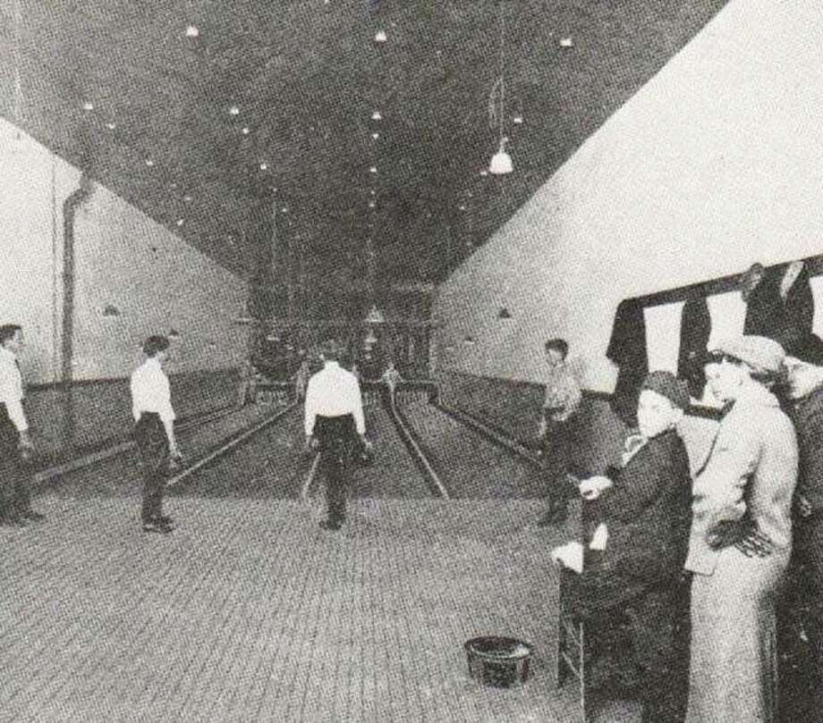 The elite Ten Pin Bowling Alley was located at 107 West Broadway, and was operated by Charles Stokes and Herman Skiff. Pin setters were agile boys who could avoid the bowling balls and flying pins. Bowling was a popular sport in Alton. From Alton Illustrated 1912. Photo: File Photo
