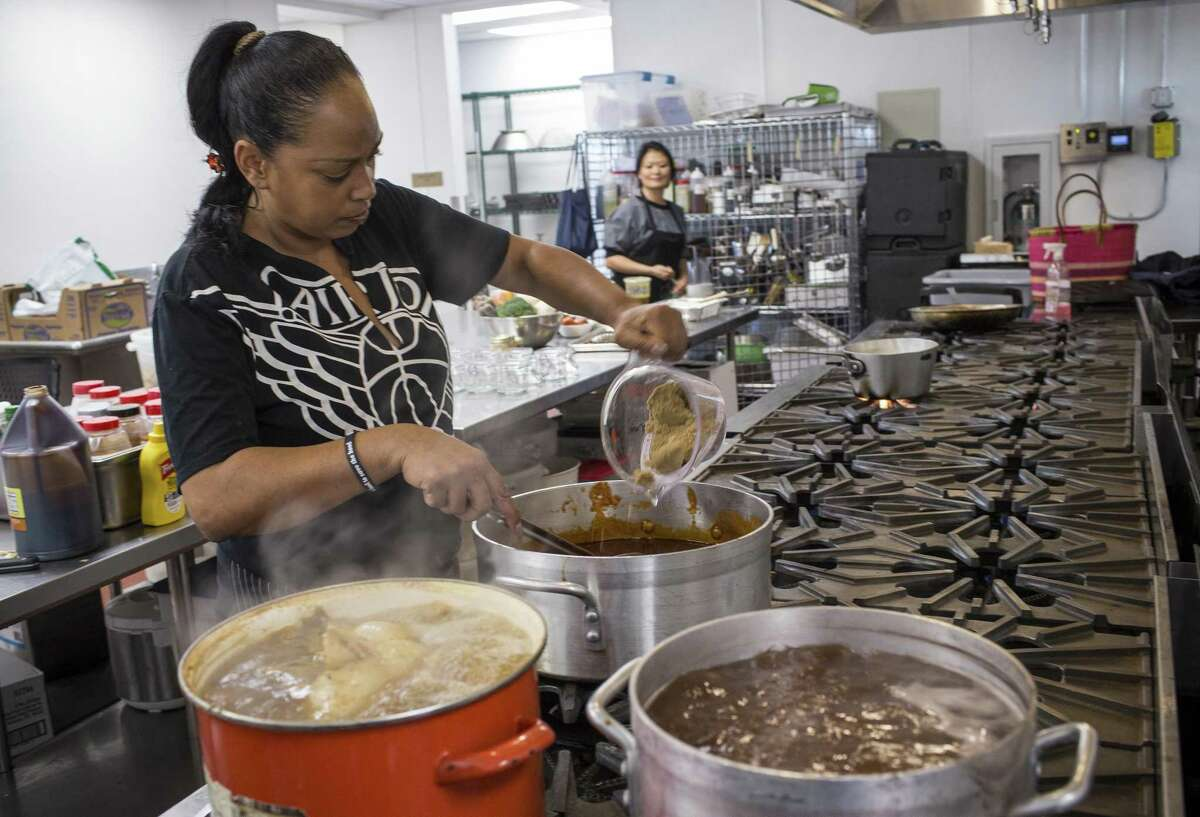 Nima Romney, owner of the Soul Bowl'z food truck, makes barbecue sauce at Eclectic Cookery.