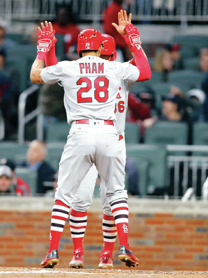 Cardinals center fielder Tommy Pham celebrates with Aledmys Diaz after hitting a two-run home run in the third inning Friday in Atlanta. Photo: AP