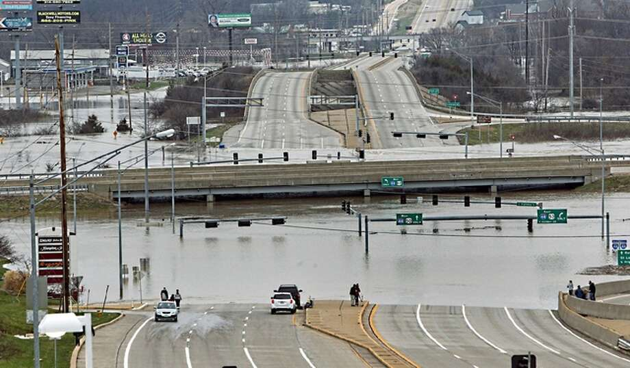 J.B. Forbes | St. Louis Post-Dispatch (via AP) Floodwater from the Meramec River surround the bridge deck of Interstate 44 and Highway 141 in southwest St. Louis County. A rare winter flood threatened nearly two dozen federal levees in Missouri and Illinois as rivers rose, prompting evacuations in several places.