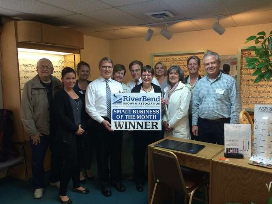 Alex Heeb/Alton Telegraph Dr. James Lieber, with wife Kathleen, stood with Riverbend Growth Association dignitaries after they were given their Small Business of the Month sign.