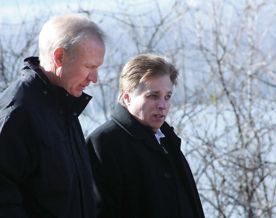 Illinois Gov. Bruce Rauner speaks with Alton Mayor Brant Walker Friday morning as they observe floodwaters at Riverview Park in Alton. Rauner toured several flood-watching spots in Alton and Grafton. Photo: Nathan Woodside   The Telegraph