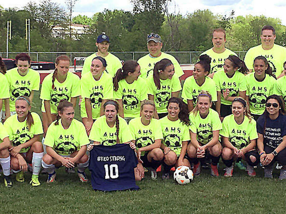 Players from the Alton and Granite City girls soccer teams gather for a group photo prior to their game Saturday at AHS. The game served as a fund-raiser to benefit Sammy Keomanivane, a former Granite city player who was injured in a motorcycle wreck April 23. More than $1,000 was raised for the fund.
