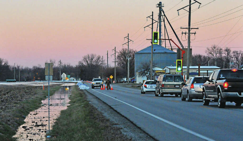 The Sangamon River at Chandlerville laps at Illinois Route 78 on Saturday. Water was rising on the west side of the town and was threatening some houses. Route 78 has been reduced to one lane in some areas. Photo: Robert Daniel | Journal-Courier