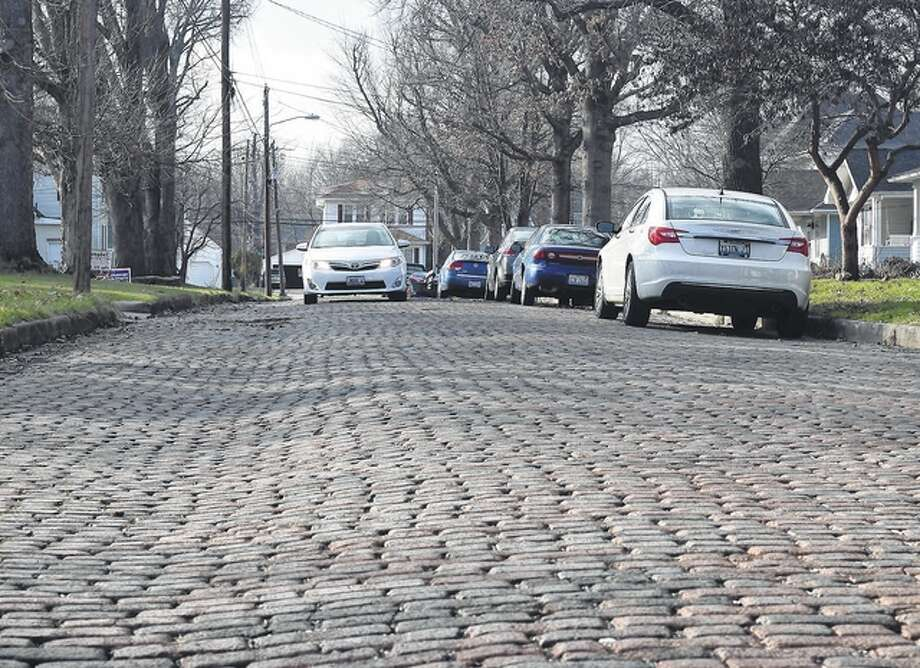 Nick Draper | Journal-Courier West Douglas Avenue is the last brick-paved street in Jacksonville. While many like the aesthetics of brick roads, the cost of maintaining and replacing bricks has many cities replacing them with other materials.