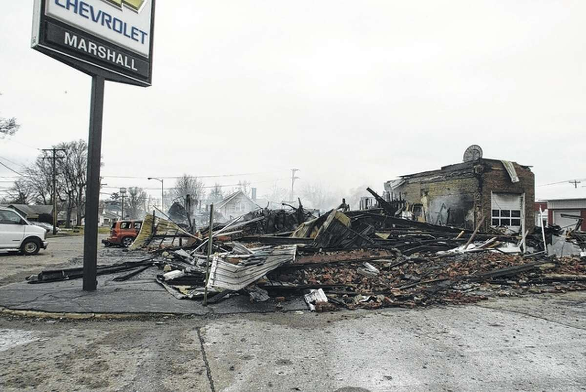 This is all that remained Sunday of Marshall Chevrolet in Winchester after an early-morning fire roared through the 85-year-old car dealership. The owners said they plan to rebuild.