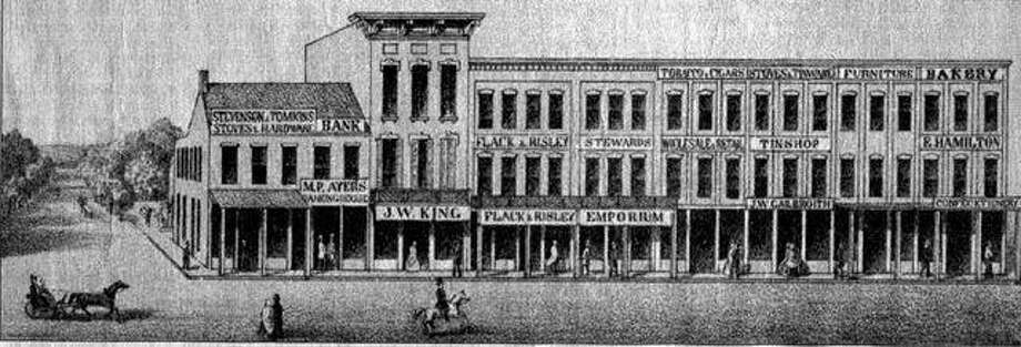 Joseph W. King's jewelry store is in the second building from the left in this 1861 lithograph showing West State Street and the north half of the west side of the Jacksonville public square. Photo: File Image