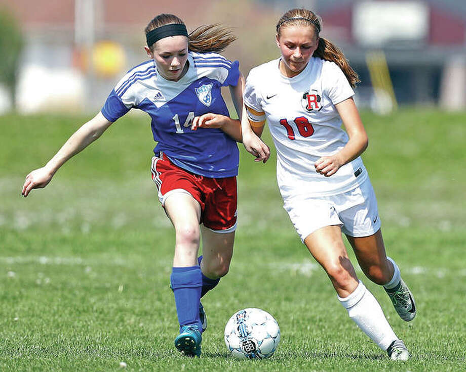 Roxana's Emma Lucas, right, and Carlinville's Rory Drew are among the scoring leaders in the St. Louis area as the Class 1A playoffs begin this week. Lucas, a junior has 25 goals and nine assists, while freshman Drew has 17 goals and eight assists. They are shown in action during an April SCC game in Wood River. Photo: Billy Hurst | For The Telegraph