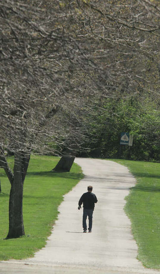A hiker makes his way down the paved hiking trail at La Vista Park in Godfrey. An open house to discuss bicycle/pedestrian trails, including one that could connect La Vista Park with Glazebrook Park, will be discussed. The meeting is 6-8 p.m. Wednesday, May 24 at Village Hall. Photo: Scott Cousins/The Telegraph