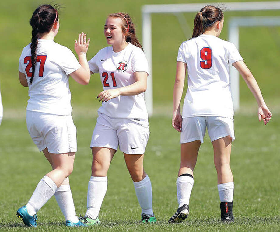 The Roxana Shells had plenty of goals to celebrate Tuesday in Olney. They knocked off Salem 9-0 in a semifinal of the Olney Class 1A Regional Tournament and will advance to Saturday's championship game. Pictured above are Alyssa Autery (27), Maebel Montano (21) and Cloe Copeland (9) celebrating during a game earlier this season. Photo: Billy Hurst | For The Telegraph